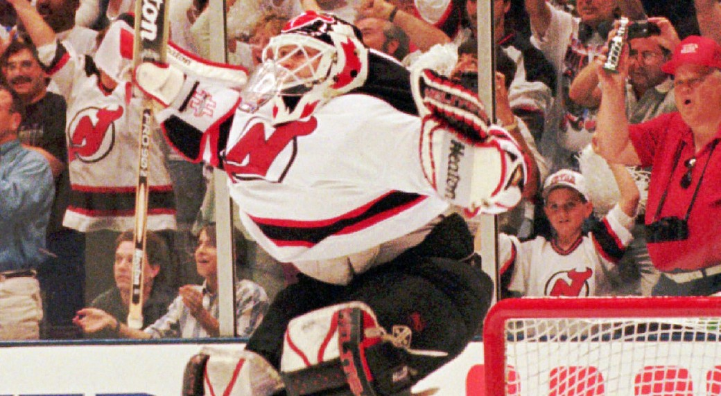 Goaltender Martin Brodeur leaps for joy in June 1995 as the New Jersey  Devils claim the franchise s first Stanley Cup. (AP) 8bc3507a937