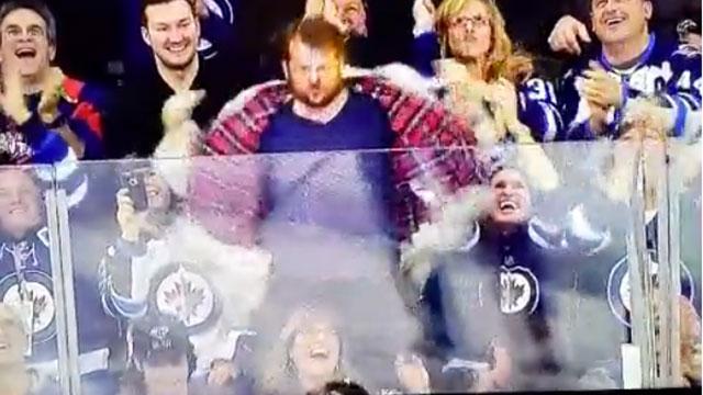 Watch: Wild Jets Fan Rocks Out In Fur Coat (video)
