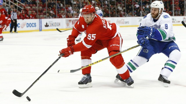 Detroit-Red-Wings-defenseman-Niklas-Kronwall-(55)-keeps-the-puck-from-Vancouver-Canucks-right-wing-Brandon-Prust-(9)-in-the-second-period-of-an-NHL-hockey-game-Friday,-Dec.-18,-2015-in-Detroit.-(AP-Photo/Paul-Sancya)