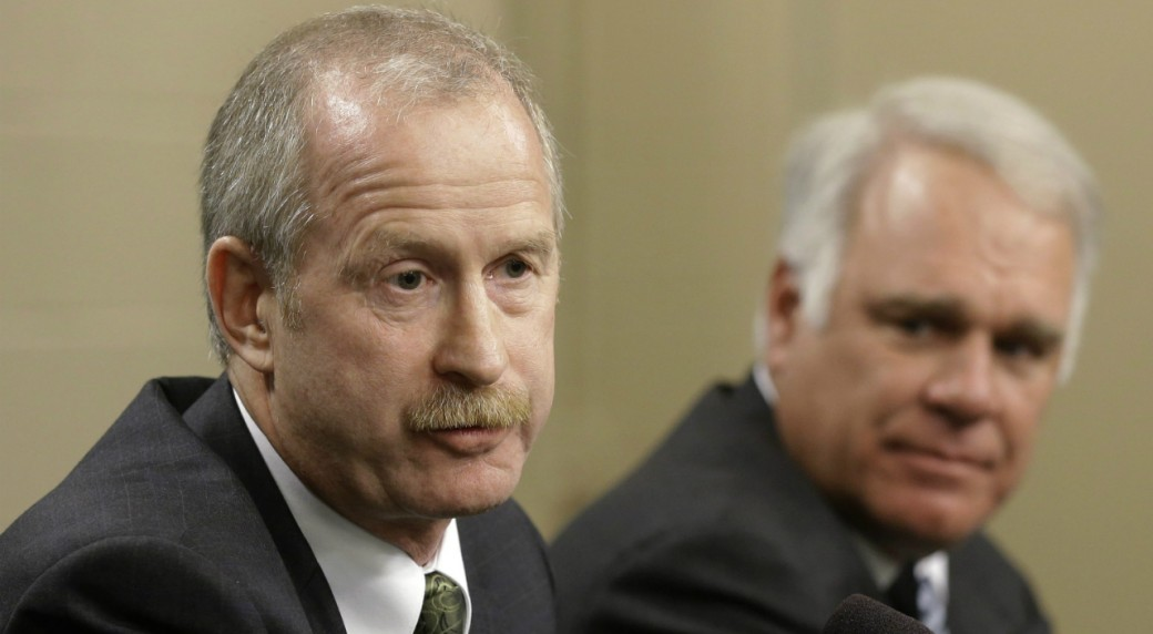 Dallas-Stars-newly-hired-general-manager-Jim-Nill,-left,-responds-to-a-reporter's-question-during-a-news-conference-as-president-and-CEO-Jim-Lites,-right,-watches-Monday,-April-29,-2013,-in-Dallas.-AP-Photo/Tony-Gutierrez)