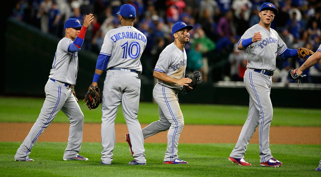 Blue Jays blow out Mariners, Happ wins 20th