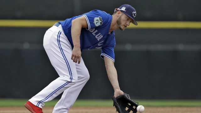 Toronto-Blue-Jays-third-baseman-Josh-Donaldson-picks-up-a-ground-ball-during-infield-drills-before-a-spring-training-baseball-game-against-the-Boston-Red-Sox-Monday,-March-13,-2017,-in-Dunedin,-Fla.-(Chris-O'Meara/AP)