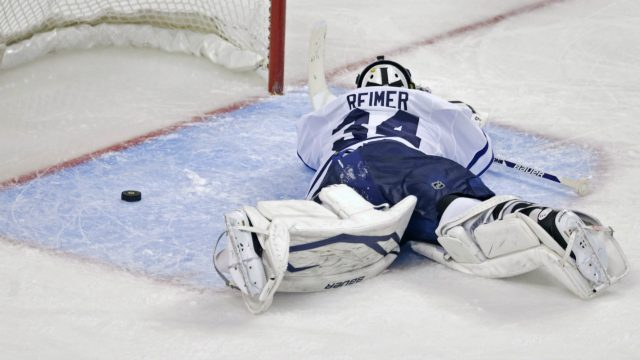 Toronto-Maple-Leafs-goalie-James-Reimer-lays-on-the-ice-after-getting-beat-on-the-game-winning-goal-by-Boston-Bruins-centre-Patrice-Bergeron-during-overtime-in-Game-7-of-their-NHL-hockey-Stanley-Cup-playoff-series-in-Boston,-Monday,-May-13,-2013.-The-Bruins-won-5-4.-(Charles-Krupa/AP)