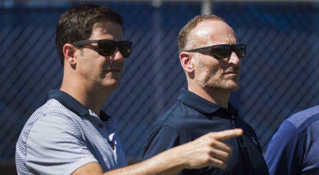 Toronto-Blue-Jays-general-manager-Ross-Atkins,-left,-talks-with-Blue-Jays-President-Mark-Shapiro,-right,-during-baseball-spring-training-in-Dunedin,-Fla.,-on-Friday,-February-24,-2017.-(Nathan-Denette/CP)