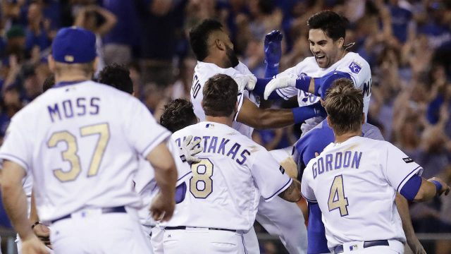 Kansas-City-Royals'-Whit-Merrifield,-top-right,-is-mobbed-by-teammates-after-hitting-a-walk-off-two-run-double-during-the-ninth-inning-of-the-team's-baseball-game-against-the-Toronto-Blue-Jays-Friday,-June-23,-2017,-in-Kansas-City,-Mo.-The-Royals-won-5-4.-(Charlie-Riedel/AP)
