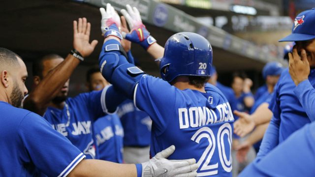 Toronto-Blue-Jays'-Josh-Donaldson-(20)-is-congratulated-in-the-dugout-following-his-solo-home-run-off-Minnesota-Twins-pitcher-Adalberto-Mejia-in-the-first-inning-of-a-baseball-game-Saturday,-Sept.-16,-2017,-in-Minneapolis.-(Jim-Mone/AP)