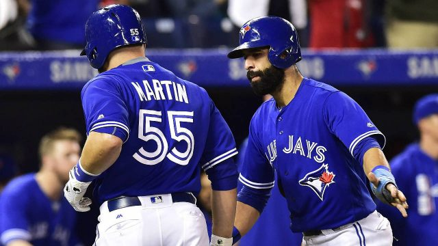 Toronto-Blue-Jays-catcher-Russell-Martin-(55)-is-congratulated-on-his-two-run-home-run-against-the-New-York-Yankees-by-Jose-Bautista-during-fourth-inning-AL-baseball-action-in-Toronto-on-Friday,-September-22,-2017.-(Frank-Gunn/CP)