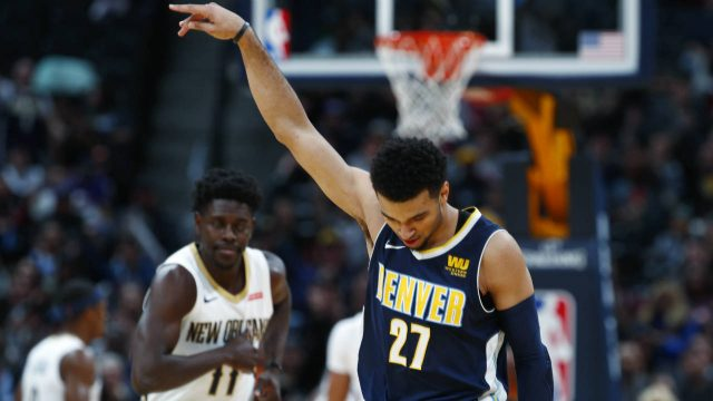 Denver-Nuggets-guard-Jamal-Murray-reacts-after-hitting-a-three-point-basket-over-New-Orleans-Pelicans-guard-Jrue-Holiday-in-the-first-half-of-an-NBA-basketball-game-Friday,-Nov.-17,-2017,-in-Denver.-(David-Zalubowski/AP)