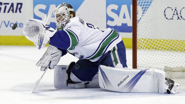 Vancouver-Canucks-goalie-Jacob-Markstrom-stops-a-shot-by-the-San-Jose-Sharks-during-the-first-period-of-an-NHL-hockey-game-Thursday,-Dec.-21,-2017,-in-San-Jose,-Calif.-(Marcio-Jose-Sanchez/AP)