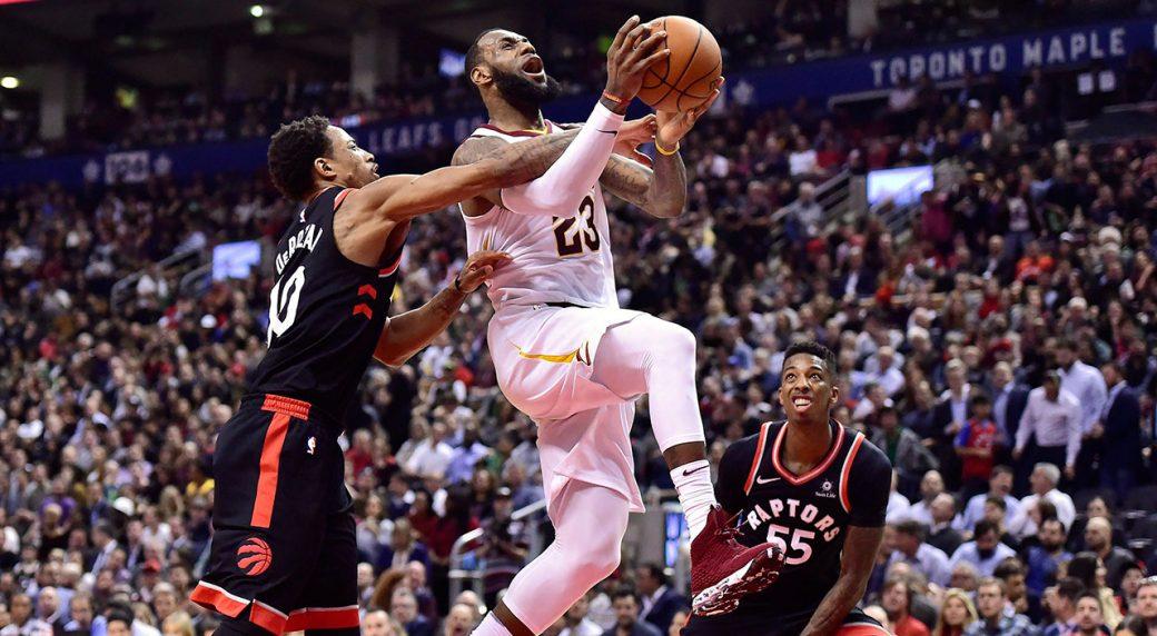 6b6a29795d7d Toronto Raptors guard DeMar DeRozan (10) fouls Cleveland Cavaliers forward  LeBron James (23) as he goes to the net during second half NBA basketball  action ...