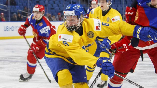 Sweden's-Rasmus-Dahlin-battles-with-Russia's-Dmitri-Sokolov,-right-during-first-period-IIHF-World-Junior-Championship-preliminary-hockey-action-in-Buffalo,-N.Y.,-Sunday,-December-31,-2017.-(Mark-Blinch/CP)