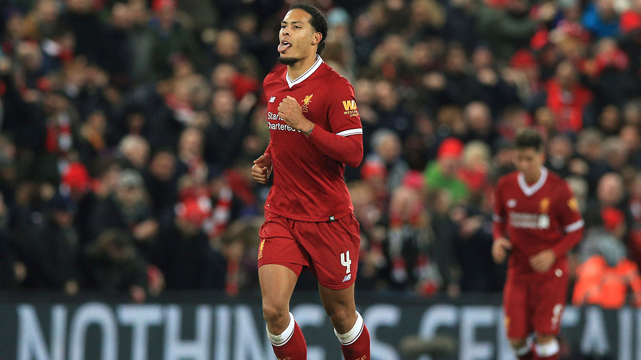 Van Dijk makes historic impression in his Liverpool debut
