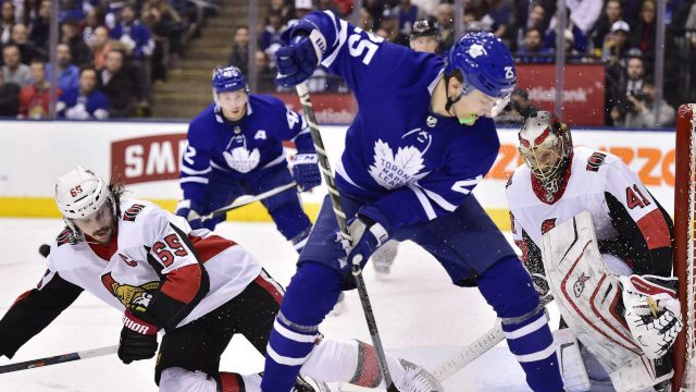 Toronto-Maple-Leafs-left-wing-James-van-Riemsdyk-(25)-tries-to-play-the-puck-by-the-side-of-the-net-as-Ottawa-Senators-goaltender-Craig-Anderson-(41)-looks-on-while-defenceman-Erik-Karlsson-(65)-defends-during-second-period-NHL-hockey-action-in-Toronto-on-Wednesday,-January-10,-2018.-(Frank-Gunn/CP)