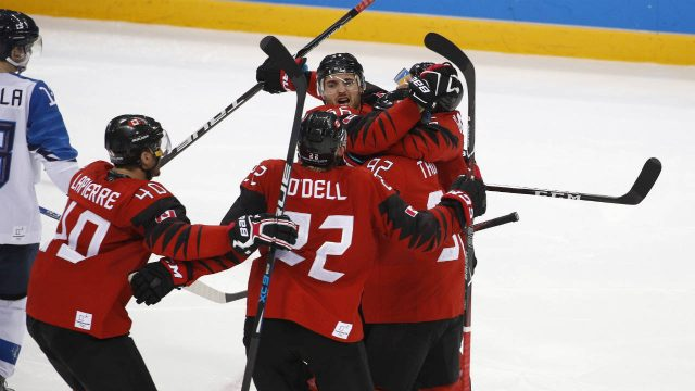 Maxim-Noreau-(56),-of-Canada,-celebrates-with-his-teammates-after-scoring-a-goal-against-Finland-during-the-third-period-of-the-quarterfinal-round-of-the-men's-hockey-game-at-the-2018-Winter-Olympics-in-Gangneung,-South-Korea,-Wednesday,-Feb.-21,-2018.-(Jae-C.-Hong/AP)