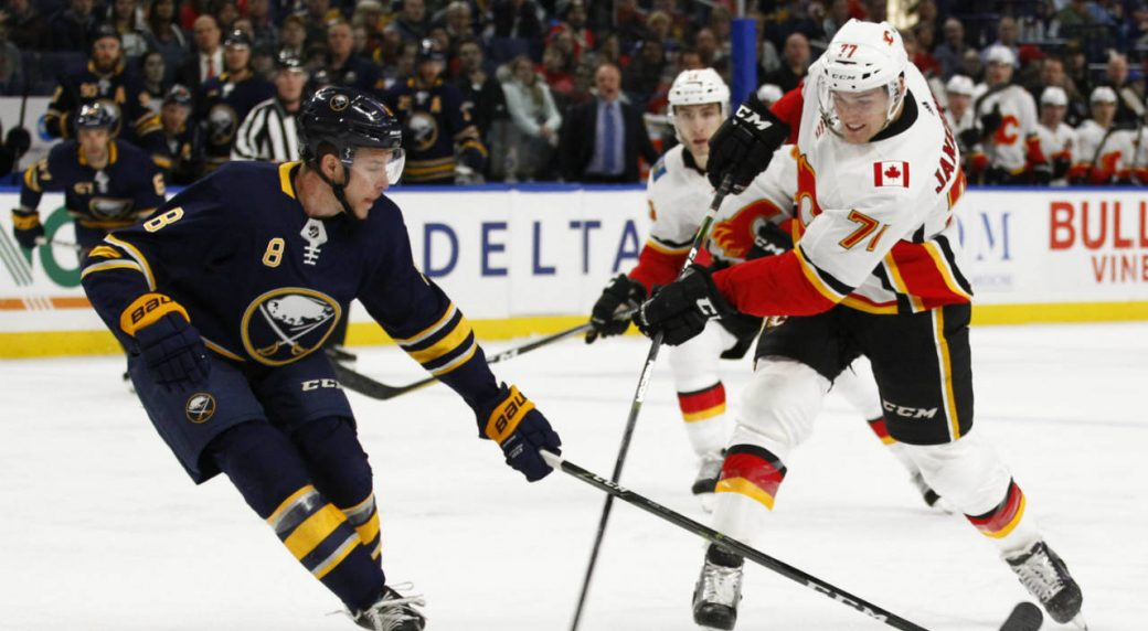 Buffalo-Sabres-Casey-Nelson-(8)-defends-Calgary-Flames-forward-Mark-Jankowski-(77)-during-the-first-period-of-an-NHL-hockey-game,-Wednesday,-March.-7,-2018,-in-Buffalo,-N.Y.-(Jeffrey-T.-Barnes/AP)