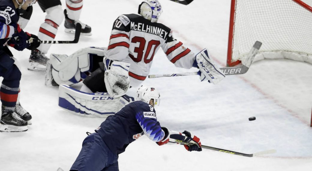 nick bonino of the united states bottom scores his side s second goal during the ice hockey world championships bronze medal match between canada and the