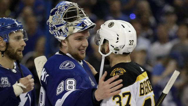 Tampa-Bay-Lightning-goaltender-Andrei-Vasilevskiy-(88)-pats-Boston-Bruins-centre-Patrice-Bergeron-(37)-after-Game-5-of-an-NHL-second-round-hockey-playoff-series-Sunday,-May-6,-2018,-in-Tampa,-Fla.