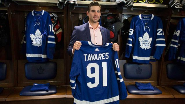 john-tavares-holds-up-maple-leafs-jersey