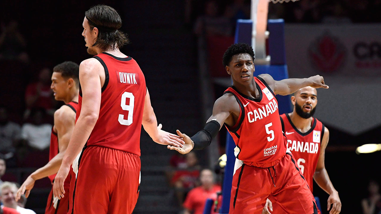 Rj_barrett_gives_kelly_olynyk_a_high_five