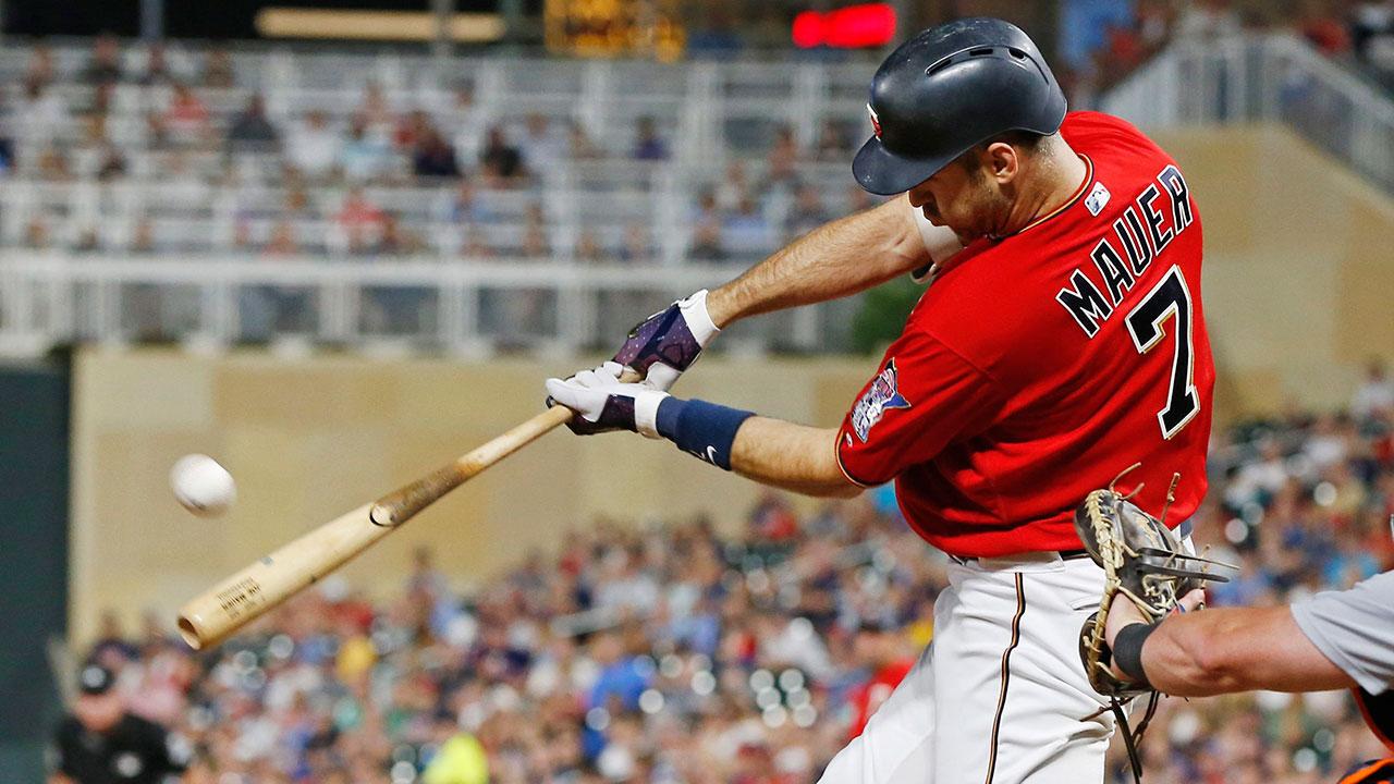 Joe_mauer_hits_a_three_run_home_run