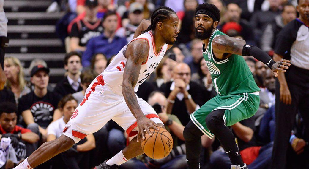 a127cdb3f9db Toronto Raptors forward Kawhi Leonard (2) moves up court as Boston Celtics  guard Kyrie Irving (11) defends during second half NBA action in Toronto on  ...