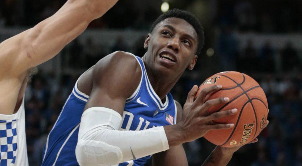 2639e64da90 Duke forward RJ Barrett (5) shoots around Kentucky forward Reid Travis (22)  during the first half of an NCAA college basketball game at the Champions  ...