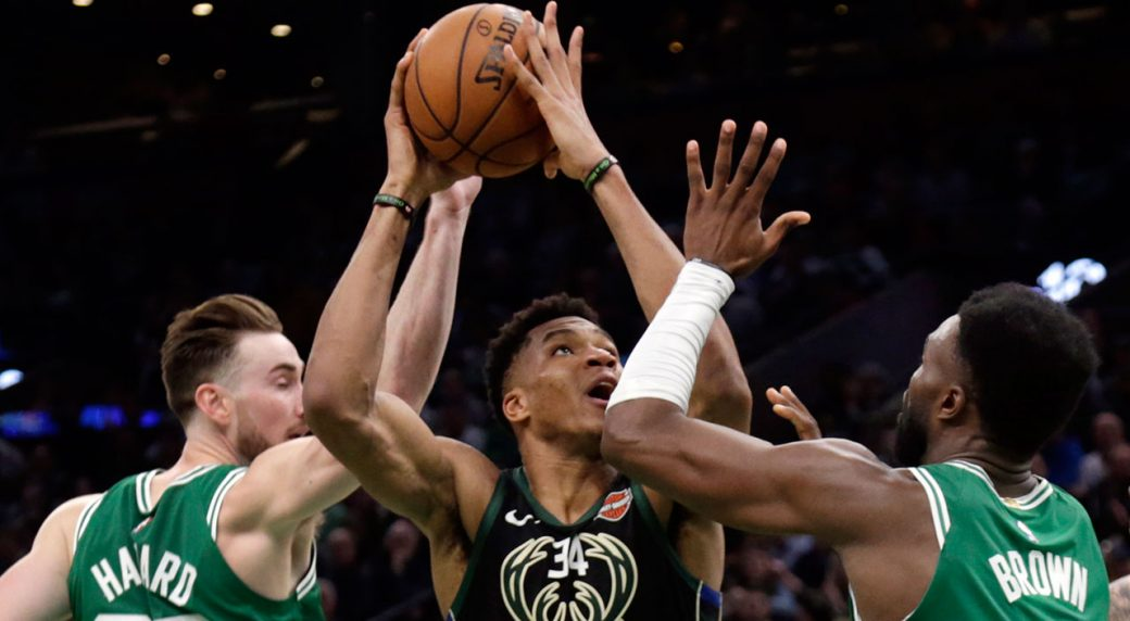 Milwaukee Bucks forward Giannis Antetokounmpo (34) goes to the hoop against  Boston Celtics forward Gordon Hayward (20) and guard Jaylen Brown. 7aad17fa1