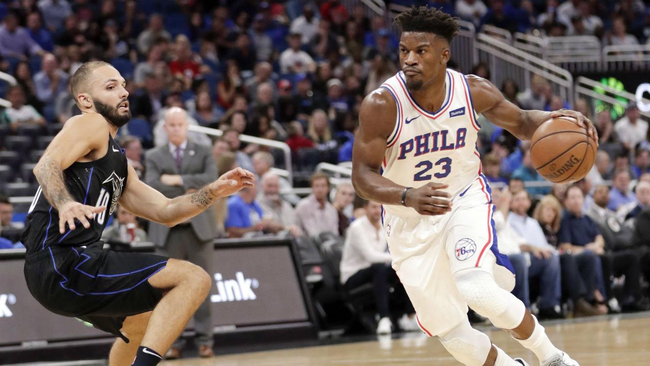Philadelphia 76ers' Jimmy Butler drives past Orlando Magic's Evan Fournier. (John Raoux/AP)