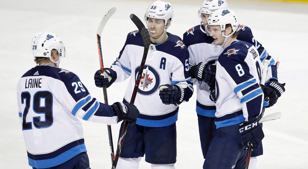 4d0b14fbf99 Winnipeg Jets players celebrate a goal by Jacob Trouba (8) during the third  period of an NHL hockey game against the New York Islanders in New York.