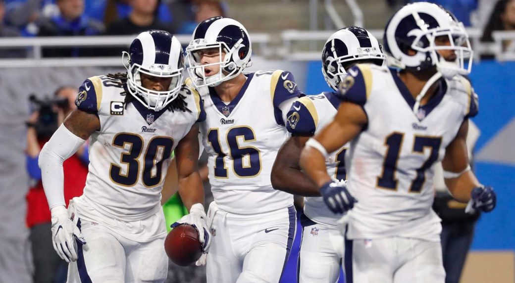 Los Angeles Rams quarterback Jared Goff (16) greets running back Todd Gurley  (30) after Gurley s 13-yard rush for a touchdown during the second half of  an ... bd19e7511
