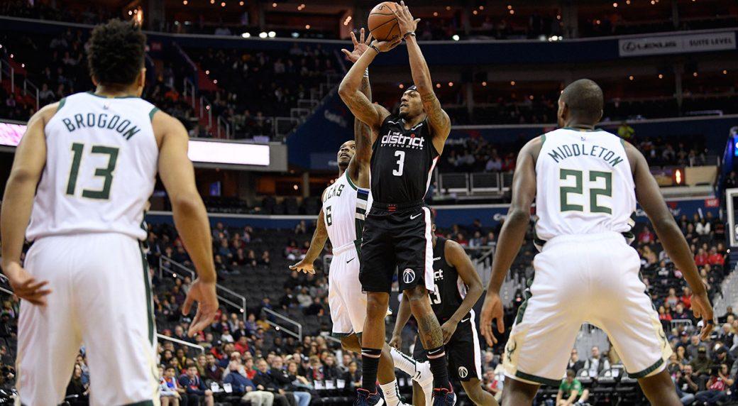 a856bf2cb7d0 Washington Wizards guard Bradley Beal (3) shoots against Milwaukee Bucks  guard Malcolm Brogdon (13)