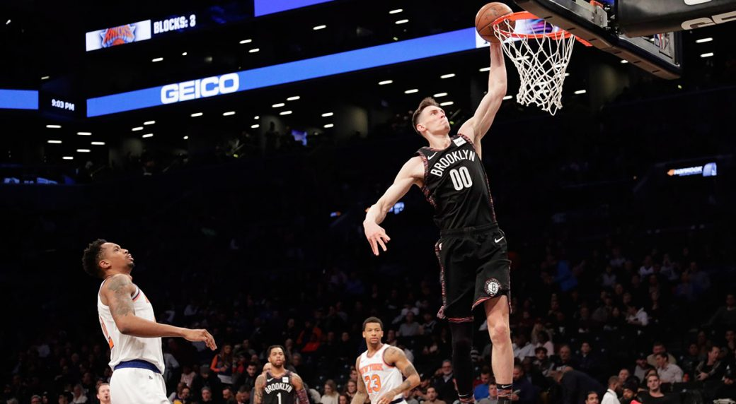 Brooklyn Nets  Rodions Kurucs (00) drives past New York Knicks  Lance Thomas  during the second half of an NBA basketball game Friday 0b61258cb
