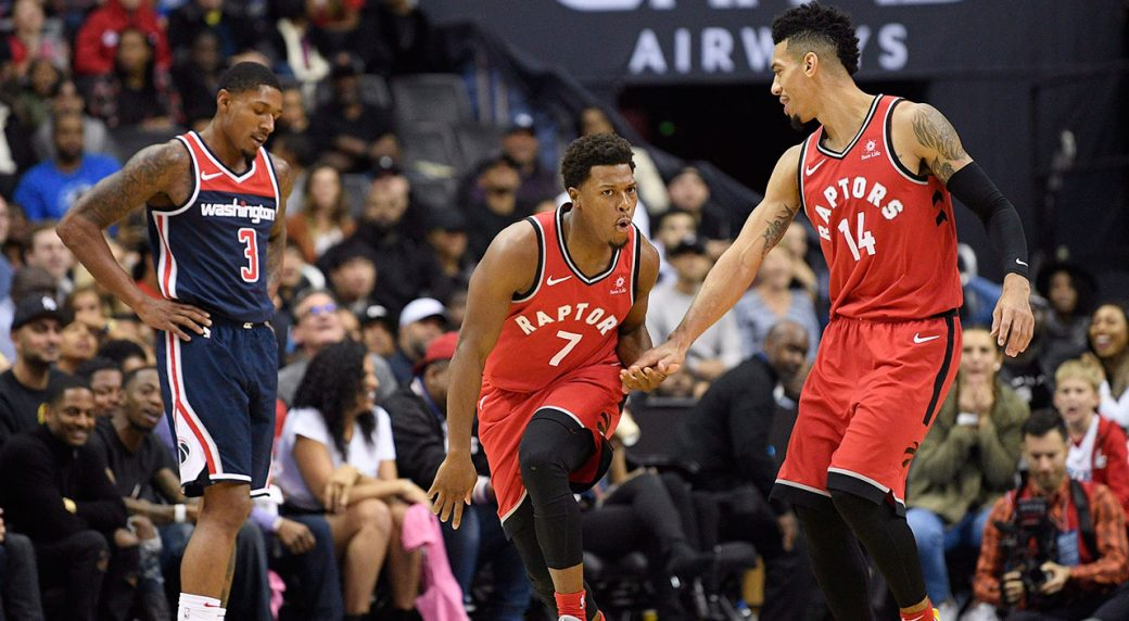 5d929779b2b Toronto Raptors guard Kyle Lowry (7) reacts with guard Danny Green (14)  after he made a three-point basket during the second half of an NBA  basketball game ...
