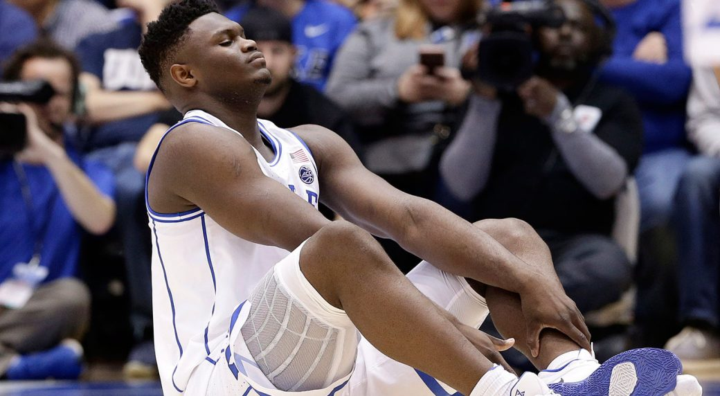 9a380cfc4ba Duke s Zion Williamson sits on the floor following a injury during the first  half of an NCAA college basketball game against North Carolina in Durham