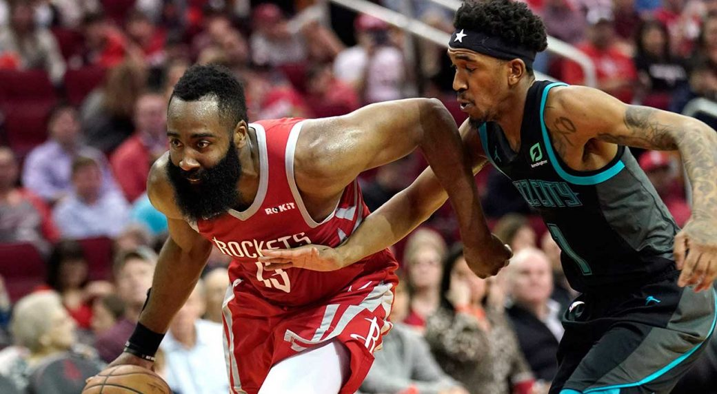 c24f2c091c0a Houston Rockets  James Harden (13) drives toward the basket as Charlotte  Hornets  Malik Monk (1) defends during the second half of an NBA basketball  game.