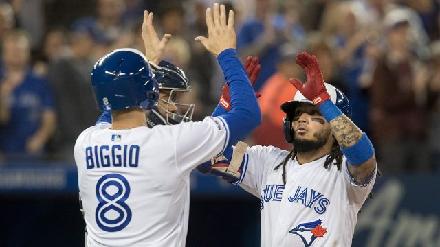 blue-jays-freddy-galvis-met-at-home-by-cavan-biggio