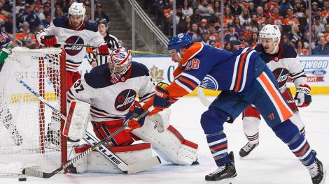 jets-connor-hellebuyck-makes-save-on-oilers-kyle-brodziak